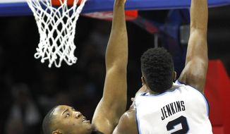 Villanova forward Kris Jenkins (2) takes a shot past Providence forward Kalif Young (13) in the first half of an NCAA college basketball game, Saturday, Jan. 21, 2017, in Philadelphia. (AP Photo/Laurence Kesterson)