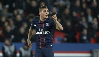 FILE - In this Sunday, Dec. 11, 2016 file photo, PSG's Marco Verratti gestures during the League One soccer match against Nice, at the Parc des Princes stadium, in Paris, France. Verratti was given a seemingly unusual yellow card for anti-sporting behavior known in the game as trickery when he knelt down and headed the ball back to his goalkeeper during a French league match against Nantes on Saturday, Jan. 21, 2017. (AP Photo/Thibault Camus, File)