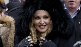 Madonna smiles before she performs during the Women's March on Washington, Saturday, Jan. 21, 2017 in Washington. (AP Photo/Jose Luis Magana)