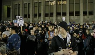 Protesters gather in front of Kane Hall on the University of Washington campus where far-right commentator Milo Yiannopoulos was giving a speech, Friday, Jan. 20, 2017, in Seattle. (AP Photo/Ted S. Warren)