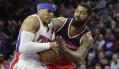 Washington Wizards forward Markieff Morris reaches in on Detroit Pistons forward Tobias Harris during the first half of an NBA basketball game, Saturday, Jan. 21, 2017, in Auburn Hills, Mich. (AP Photo/Carlos Osorio)
