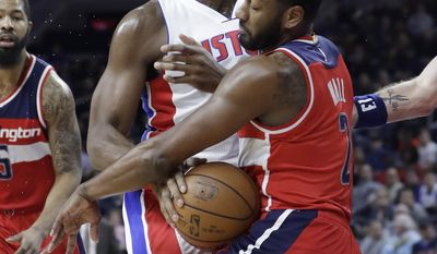 Washington Wizards guard John Wall (2) steals the ball away from Detroit Pistons center Andre Drummond during the first half of an NBA basketball game, Saturday, Jan. 21, 2017, in Auburn Hills, Mich. (AP Photo/Carlos Osorio)