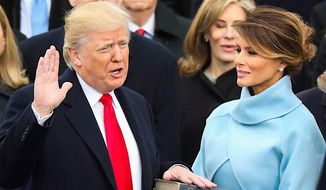 President Trump's oath of office drew a record-breaking online audience, says a content provider. (Associated Press)