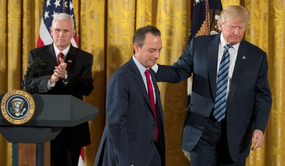 "President Trump leads Chief of Staff Reince Priebus off the stage on Sunday after a swearing-in ceremony for 30 senior staff members. With Vice President Mike Pence (left), he gave a pep talk to ""prove worthy of this moment in history."" (Associated Press)"