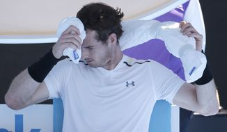 Britain's Andy Murray cools off during a break in play against Germany's Mischa Zverev during their fourth round match at the Australian Open tennis championships in Melbourne, Australia, Sunday, Jan. 22, 2017. (AP Photo/Aaron Favila)