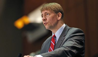 In this March 26, 2015, file photo, Consumer Financial Protection Bureau Director Richard Cordray speaks during a panel discussion in Richmond, Va. (AP Photo/Steve Helber, File)