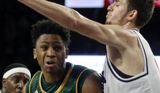 George Mason's Otis Livingston II, front left, duels with Richmond's T.J. Cline on a drive to the hoop in the second half of an NCAA college basketball game Sunday, Jan. 22, 2017. ( Joe Mahoney/Richmond Times-Dispatch via AP)