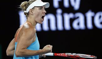 Germany's Angelique Kerber celebrates a point against United States' Coco Vandeweghe during their fourth round match at the Australian Open tennis championships in Melbourne, Australia, Sunday, Jan. 22, 2017. (AP Photo/Dita Alangkara)