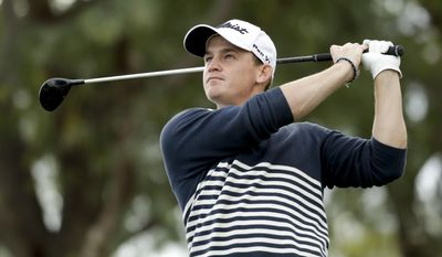 Bud Cauley watches his tee shot on the sixth hole during the final round of the CareerBuilder Challenge golf tournament on the Stadium Course at PGA West, Sunday, Jan. 22, 2017, in La Quinta, Calif. (AP Photo/Chris Carlson)