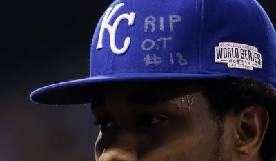 FILE - In this Tuesday, Oct. 28, 2014, file photo, Kansas City Royals pitcher Yordano Ventura has an RIP O.T. #18 on his hat, paying tribute to his friend and countryman, Cardinals outfielder Oscar Taveras as he walks off the field during the first inning of Game 6 of baseball's World Series against the San Francisco Giants in Kansas City, Mo. Ventura, whose electric arm and confident demeanor helped lead his long-suffering team to the 2015 World Series title, died in a car crash in his native Dominican Republic early Sunday, Jan. 22, 2017. Taveras also was killed in a car accident in the Dominican Republic, and his funeral occurred just hours before Ventura stepped on the mound for Game 6. (AP Photo/David J. Phillip, File)