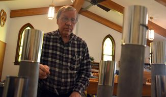 FOR RELEASE SUNDAY, JANUARY 22, 2017, AT 12:01 A.M. CST.-  John Nolte, of Nolte Organ Building from West Allis, Wis. tests pipes that have been altered for the organ at St. Paul Lutheran Church of Plymouth. The project cost just shy of $10,000. (Scott Koperski /Beatrice Daily Sun via AP)