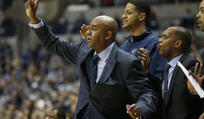 Georgetown head coach John Thompson, center, directs his team from the bench during the first half of an NCAA college basketball game, Sunday, Jan. 22, 2017, in Cincinnati. AP Photo/Gary Landers)