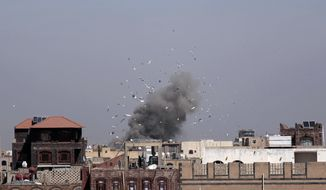 Debris and smoke rise after a Saudi-led airstrike hit an army base, in Sanaa, Yemen, on Jan. 22. (Associated Press)