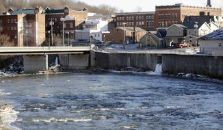 FILE - In this Jan. 21, 2016 file photo, the Hoosic River runs through the village of Hoosick Falls, N.Y. New York Gov. Andrew Cuomo has a plan to spend $2 billion to address water contamination and the state's aging, leaky pipes as well as fund efforts to clean up toxic contaminants like the industrial chemical PFOA that tainted the tap water of the upstate village. (AP Photo/Mike Groll, File)