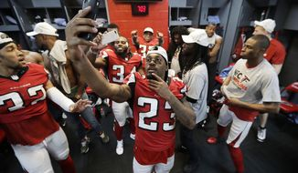 Atlanta Falcons' Robert Alford takes a selflie after the NFL football NFC championship game against the Green Bay Packers Sunday, Jan. 22, 2017, in Atlanta. The Falcons won 44-21 to advance to Super Bowl LI. (AP Photo/David J. Phillip)