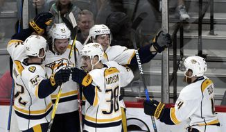 Nashville Predators' Matt Irwin (52), Ryan Johansen (92), Viktor Arvidsson (38), of Sweden, Filip Forsberg (9), of Sweden, and Ryan Ellis (4) celebrate a goal by Forsberg against the Minnesota Wild during the third period of an NHL hockey game Sunday, Jan. 22, 2017, in St. Paul, Minn. The Predators won 4-2. (AP Photo/Hannah Foslien)