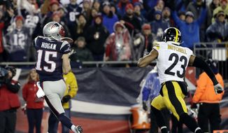 New England Patriots wide receiver Chris Hogan (15) makes a touchdown reception against Pittsburgh Steelers safety Mike Mitchell (23) during the first half of the AFC championship NFL football game, Sunday, Jan. 22, 2017, in Foxborough, Mass. (AP Photo/Matt Slocum)