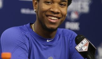 FILE - In this Thursday, Oct. 29, 2015, file photo, Kansas City Royals starting pitcher Yordano Ventura reacts to a question during a news conference before Game 3 of the Major League Baseball World Series against the New York Mets in New York. Ventura and former major leaguer Andy Marte died in separate traffic accidents early Sunday, Jan. 22, 2017, in their native Dominican Republic. (AP Photo/Frank Franklin II, File)