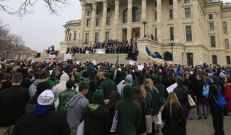 Pro-life activists rally at the Kansas Statehouse on Monday to mark the 1973 Supreme Court decision that legalized abortion nationwide. (Associated Press)