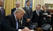 From left, White House Chief of Staff Reince Priebus, National Trade Council adviser Peter Navarro, Senior Adviser Jared Kushner, policy adviser Stephen Miller, and chief strategist Steve Bannon watch as President Donald Trump signs an executive order in the Oval Office of the White House, Monday, Jan. 23, 2017, in Washington. (AP Photo/Evan Vucci)