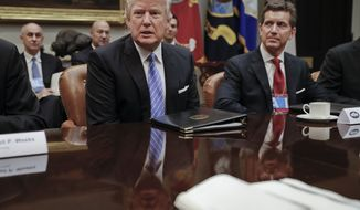 President Donald Trump speaks while hosting a breakfast with business leaders in the Roosevelt Room of the White House in Washington, Monday, Jan. 23, 2017. At left is Alex Gorsky, chairman and chief executive officer of Johnson & Johnson. (AP Photo/Pablo Martinez Monsivais)