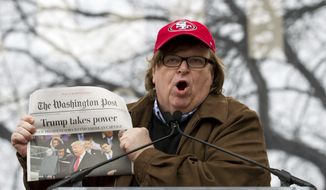 Film director Michael Moore speaks to the crowd during the Women's March rally, Saturday, Jan. 21, 2017, in Washington. (AP Photo/Jose Luis Magana)