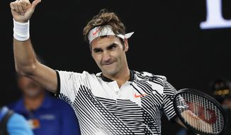 Switzerland's Roger Federer celebrates his win over Japan's Kei Nishikori during their fourth round match at the Australian Open tennis championships in Melbourne, Australia, Sunday, Jan. 22, 2017. (AP Photo/Dita Alangkara)