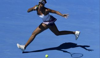 United States' Venus Williams makes a forehand return to Russia's Anastasia Pavlyuchenkova during their quarterfinal at the Australian Open tennis championships in Melbourne, Australia, Tuesday, Jan. 24, 2017. (AP Photo/Andy Brownbill)