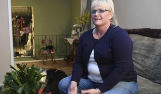 In this Sunday, Jan. 22, 2017, photo, Kim Novak is interviewed at her home in North Spokane, Wash. Novak, who was trapped in a burning car, is hailing a Washington state officer as a hero after he bashed in her window and pulled her to safety, a rescue caught on the officer's body camera on Friday. (Jesse Tinsley/The Spokesman-Review via AP)