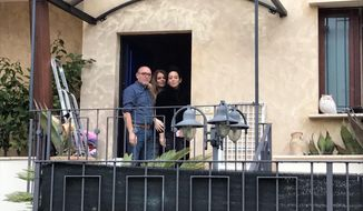 Avalanche survivor Giorgia Galassi, wearing black at right, smiles with her parents mother Isa Toccotelli, center, and Tomasso Galassi, at their home in Giulianova, Italy, Monday, Jan. 23, 2017. Galassi and her boyfriend Vincenzo Forti were at the Hotel Rigopiano when the avalanche buried the hotel on Jan. 18 and were rescued three days later. (AP Photo/Colleen Barry)