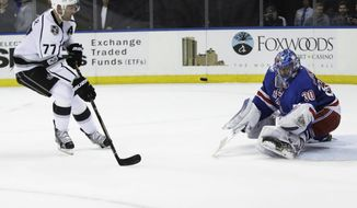 Los Angeles Kings' Jeff Carter (77) attempts to score as New York Rangers goalie Henrik Lundqvist (30), of Sweden, stops a shot on the goal during the first period of an NHL hockey game, Monday, Jan. 23, 2017, in New York. (AP Photo/Frank Franklin II)