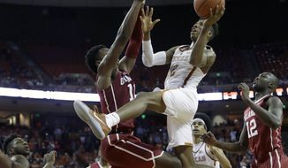 Texas guard Kerwin Roach Jr. (12) drives to the basket against Oklahoma forward Kristian Doolittle (11) during the second half of an NCAA college basketball game, Monday, Jan. 23, 2017, in Austin, Texas. Texas won 84-83. (AP Photo/Eric Gay)