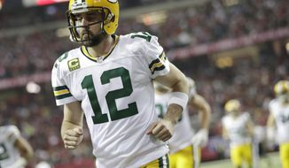 Green Bay Packers' Aaron Rodgers heads to the locker room after the first half of the NFL football NFC championship game against the Atlanta Falcons, Sunday, Jan. 22, 2017, in Atlanta. (AP Photo/David Goldman)