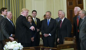 President Donald Trump, third from left, speaks during a reception for House and Senate leaders in the the State Dining Room of the White House in Washington, Monday, Jan. 23, 2017. He is surrounded by, from left, adviser Jared Kushner, House Minority Whip Steny Hoyer, D-Md., House Minority Leader Nancy Pelosi of Calif., House Speaker Paul Ryan of Wis., Senate Minority Leader Charles Schumer, D-N.Y., House Majority Leader Kevin McCarthy of Calif., Vice President Mike Pence, Senate Majority Whip Sen. John Cornyn, R-Texas., and Senate Majority Leader Mitch McConnell of Ky. (AP Photo/Susan Walsh)