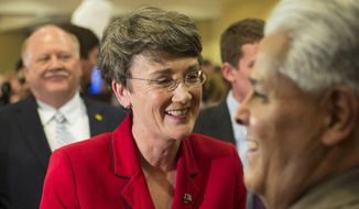 FILE - In this Nov. 6, 2012 file photo, Heather Wilson is seen in Albuquerque, N.M. President Donald Trump is planning to nominate the former New Mexico Rep. Heather Wilson as secretary of the Air Force. In confirmed, she would be the first Air Force Academy graduate to hold the position.  (AP Photo/Jake Schoellkopf, File)