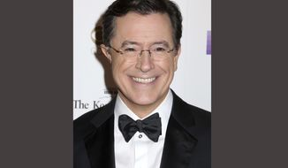 FILE - In this Dec. 6, 2015 file photo, Stephen Colbert attends the 38th Annual Kennedy Center Honors at The Kennedy Center Hall of States in Washington. Colbert will host the annual Emmy Awards telecast, this year to be shown on his home network of CBS on Sept. 17 in Los Angeles. (Photo by Greg Allen/Invision/AP, File)