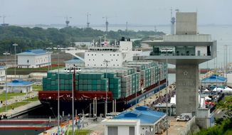 One of the locks of the Panama Canal showing new construction        Associated Press photo
