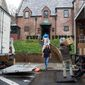 Movers, under the supervision of White House ushers, move President Barack Obama's family's belongings into their rented house in the Kalorama neighborhood of Washington, Tuesday, Jan. 17, 2017. (AP Photo/Cliff Owen) (Associated Press)