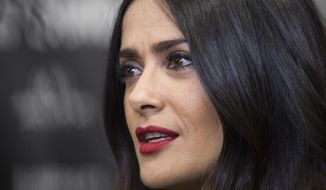 "Actress Salma Hayek speaks to reporters at the premiere of the film ""Beatriz at Dinner"" at the Eccles Theatre during the 2017 Sundance Film Festival on Monday, Jan. 23, 2017, in Park City, Utah. (Photo by Arthur Mola/Invision/AP)"