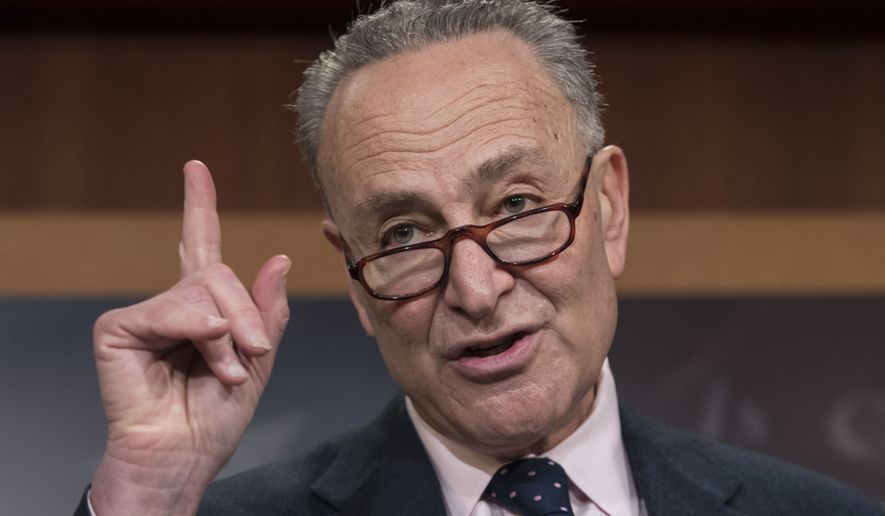 Senate Minority Leader Charles Schumer, D-N.Y., accompanied by other Senate Democrats, speaks during a news conference on Capitol Hill in Washington, Tuesday, Jan. 24, 2017. (AP Photo/J. Scott Applewhite) ** FILE **