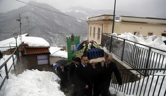 The coffin of Alessandro Giancaterino, one of the victims of the avalanche which buried the Hotel Rigopiano, is shoulder carried prior to the start of the funeral service in Farindola, central Italy,Tuesday, Jan. 24, 2017. The death toll from an avalanche in central Italy climbed to 14 on Tuesday as hopes began to fade that any of the 15 people still missing might be found alive under a mountain resort buried by tons of snow and rubble. (AP Photo/Gregorio Borgia)