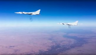 This photo provided by the Russian Defense Ministry Press Service shows Russian air force Tu-22M3 bombers strike the Islamic State group targets in Syria on Tuesday, Jan. 24, 2017. The mission, the third such bombing raid in four days, targeted the Islamic State group around Deir el-Zour in eastern Syria where the Islamic State group has launched an offensive against Syrian government forces. (Russian Defense Ministry Press Service Photo via AP)