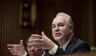 Health and Human Services Secretary-designate, Rep. Tom Price, R-Ga., right, accompanied by Sen. Johnny Isakson, R-Ga., testifies on Capitol Hill in Washington, Tuesday, Jan. 24, 2017, at his confirmation hearing before the Senate Finance Committee. (AP Photo/Andrew Harnik)