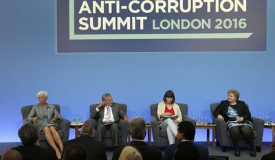 In this Thursday, May 12, 2016 file photo, Christine Lagarde, Managing Director of the International Monetary Fund, from left, Jose Ugaz, Transparency International, Daria Kaleniuk and Norway's Prime Minister Erna Solberg take part in a panel discussion at the Anti-Corruption Summit in London. Watchdog group Transparency International on Wednesday Jan. 25, 2017, is warning that people who turn to populist politicians who promise to change systems and end corruption may only be feeding the problem. (AP Photo/Frank Augstein, Pool, File)