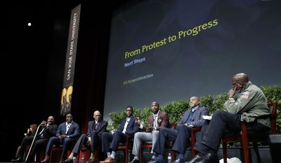 "Dr. Harry Edwards, at right, moderates a sports and activism panel entitled ""From Protest to Progress: Next Steps"" with former and current professional athletes in including, from left, Jim Brown, Takeo Spikes, Kareem Abdul-Jabbar, Chris Webber, Anquan Boldin and Tommie Smith Tuesday, Jan. 24, 2017, in San Jose, Calif. (AP Photo/Marcio Jose Sanchez)"
