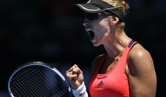 Croatia's Mirjana Lucic-Baroni reacts after winning a point against Karolina Pliskova of the Czech Republic during their quarterfinal at the Australian Open tennis championships in Melbourne, Australia, Wednesday, Jan. 25, 2017. (AP Photo/Andy Brownbill)