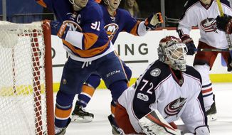New York Islanders' John Tavares (91) and Shane Prince (11) celebrate Columbus Blue Jackets goalie Sergei Bobrovsky (72) reacts to a goal by Nikolay Kulemin during the second period of an NHL hockey game, Tuesday, Jan. 24, 2017, in New York. (AP Photo/Frank Franklin II)
