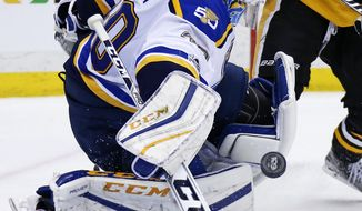 St. Louis Blues goalie Carter Hutton blocks a shot during the second period of the team's NHL hockey game against the Pittsburgh Penguins in Pittsburgh, Tuesday, Jan. 24, 2017. (AP Photo/Gene J. Puskar)