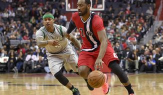 Washington Wizards guard John Wall (2) drives to the basket past Boston Celtics guard Isaiah Thomas (4) during the first half of an NBA basketball game, Tuesday, Jan. 24, 2017, in Washington. (AP Photo/Nick Wass)