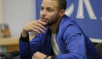 """Golden State Warrior's Stephen Curry speaks during a news conference at his former high school in Charlotte, N.C., Tuesday, Jan. 24, 2017. Curry will be honored during his return home to Charlotte. His high school will be retiring his number while Davidson College will honor him by renaming a section of their arena """"Section 30."""" (AP Photo/Chuck Burton)"""